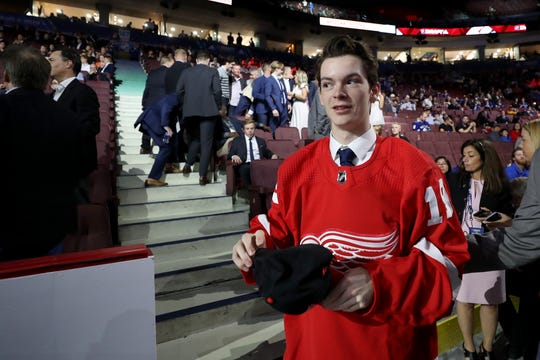 Ethan Phillips reacts after being selected 97th overall by the Red Wings during the NHL draft June 22 in Vancouver.