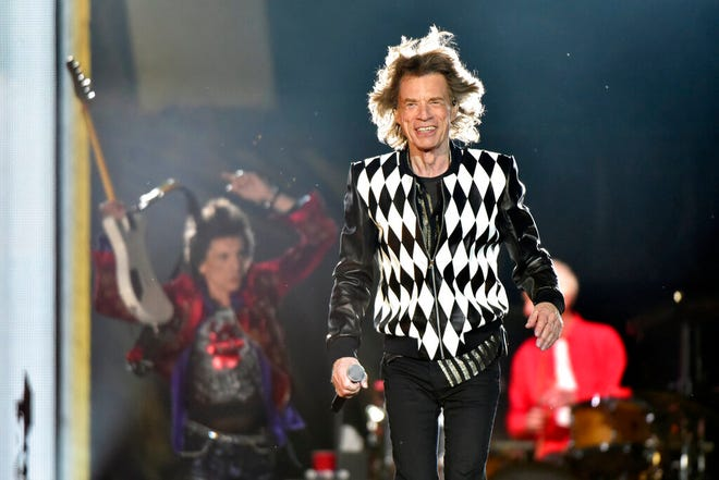 "Ron Wood, left, and Mick Jagger, of the Rolling Stones perform during the ""No Filter"" tour at Soldier Field on Friday."