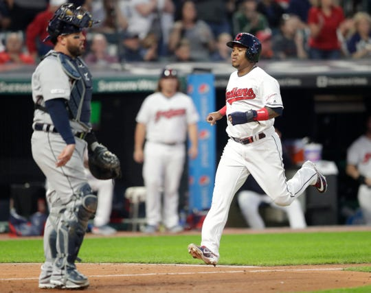 Indians' Jose Ramirez, right, scores as Tigers catcher Bobby Wilson waits in the sixth inning on Friday.