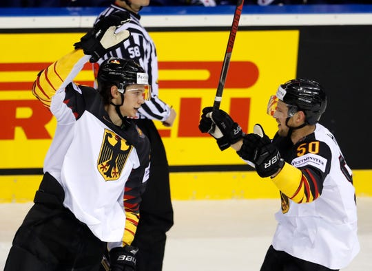 Germany's Moritz Seider, left, was Detroit's first-round pick in 2019.