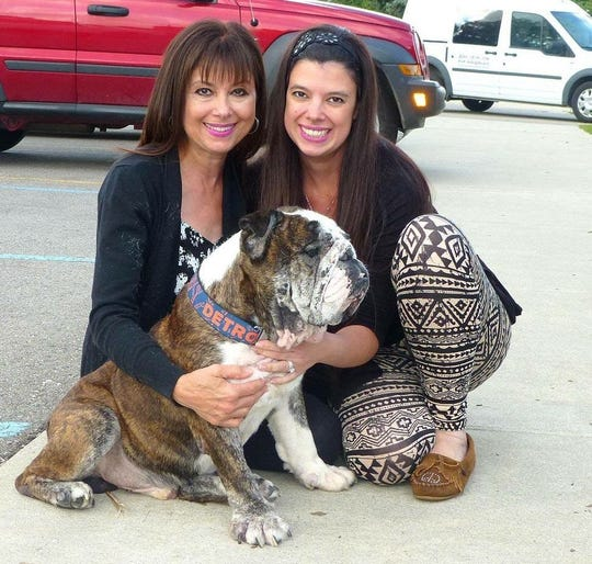 Gail Montgomery and her daughter Lauren with Bronx, an English bulldog Almost Home spent thousands to help