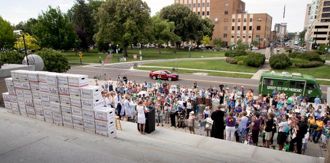 In this July 6, 2018, file photo, volunteers from around Idaho belonging to various organizations gather on the steps of the Idaho Capital Building after a signature campaign gathered over 70,000 voter signatures petitioning for an initiative for Medicaid expansion be placed on the November election ballot.
