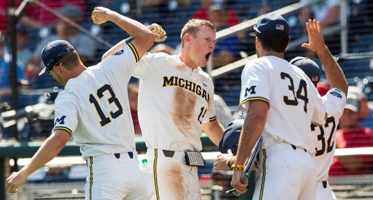 Michigan's Jimmy Kerr celebrates one of his two home runs against Texas Tech in Friday's 15-3 win.