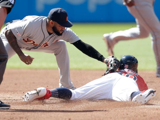 Detroit's Ronny Rodriguez, left, tags out Cleveland's Tyler Naquin on a steal attempt at second base.