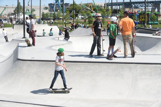 Skaters try out the Riverside Skatepark before its opening ceremony on Saturday.
