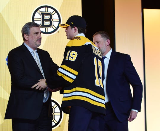 Jun 21, 2019; Vancouver, BC, Canada;  John Beecher walks to the stage after being selected as the number thirty overall pick to the Boston Bruins in the first round of the 2019 NHL Draft at Rogers Arena. Mandatory Credit: Anne-Marie Sorvin-USA TODAY Sports