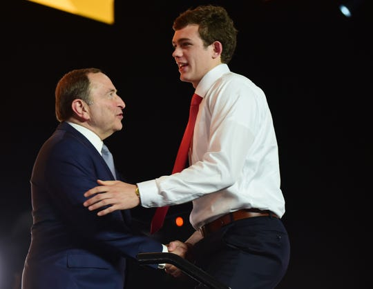 Jun 21, 2019; Vancouver, BC, Canada;  John Beecher greets NHL commissioner Gary Bettman after being selected as the number thirty overall pick to the Boston Bruins in the first round of the 2019 NHL Draft at Rogers Arena. Mandatory Credit: Anne-Marie Sorvin-USA TODAY Sports