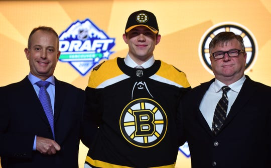 Jun 21, 2019; Vancouver, BC, Canada;  John Beecher poses for a photo after being selected as the number thirty overall pick to the Boston Bruins in the first round of the 2019 NHL Draft at Rogers Arena. Mandatory Credit: Anne-Marie Sorvin-USA TODAY Sports
