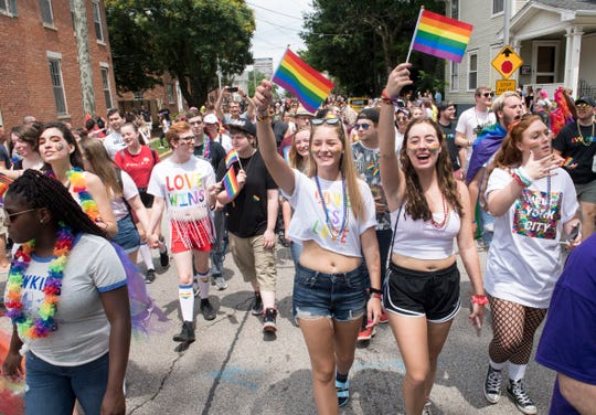 Parade walkers wave the Rainbow flag during the River City Pride Parade Saturday, June 22, 2019.