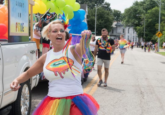 Michelle Thomas with Boyd Electric throws beads to the crowd during the River City Pride Parade Saturday, June 22, 2019.
