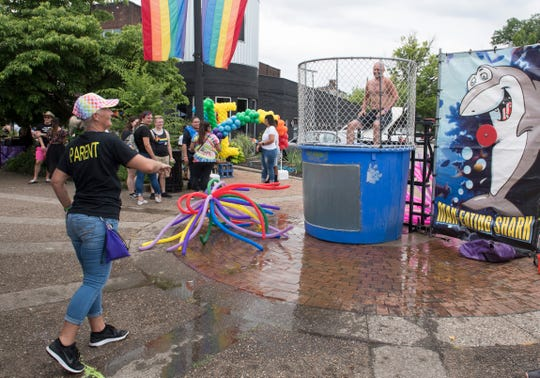 Jina Adcock attempts to dunk Oliver Muf during the River City Pride Festival Saturday, June 22, 2019.