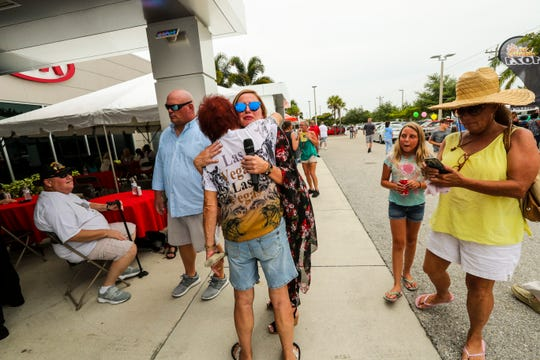 Caroline Renfro gets a hug from Heidi Schindler, of Cape Coral. Renfro's return to Fuccillo Kia was celebrated with a party Saturday, June 22, 2019, at the car dealership off Pine Island Road. Billy Fuccillo, owner of Fuccillo Automotive Group, was there to welcome her back officially. Renfro and Fucillo recorded TV commercials in and around the cars while their fans and car buyers watched.
