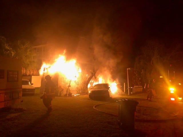 A fiery blaze engulfs a Bokeelia trailer home and car early Saturday morning.