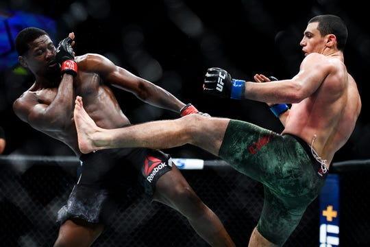 Alessio Di Chirico kicks Kevin Holland in their middleweight bout during UFC Fight Night at the Bon Secours Wellness Arena Saturday, June 22, 2019.