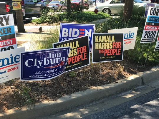 Volunteers placed campaign signs for Democratic presidential candidates outside the EdVenture Children's Museum in Columbia where Jim Clyburn's World Famous Fish Fry was held Friday night.