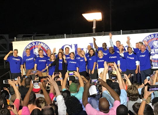 21 Democratic presidential candidates stand on stage with U.S. Rep. James Clyburn at the end of his World Famous Fish Fry in Columbia on Friday night.