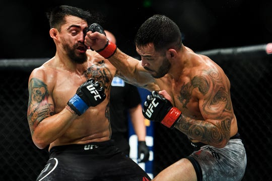 Dan Ige lands a punch on Kevin Aguilar in their bout during UFC Fight Night at the Bon Secours Wellness Arena Saturday, June 22, 2019.