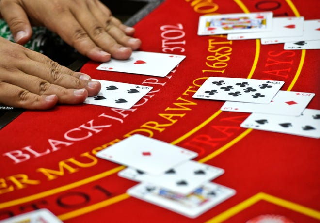 A round of blackjack is dealt within the House of Cards at the Liberation carnival in HagŒt–a on Saturday, June 22, 2019.
