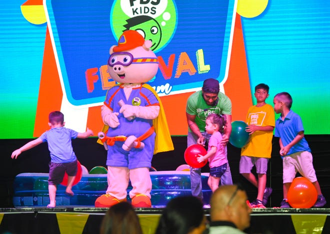 Children interact onstage with Public Broadcasting Service character, Alpha Pig, during the 2019 PBS Kids Festival at the University of Guam's Calvo Field House in Mangilao on Saturday, June 22, 2019.