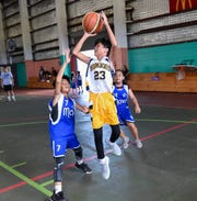 Yellow Jackets White player Arlan Devera (23) pulls up for a jump shot against the Mavericks Basketball Club during a Guam Youth Basketball Association Drug Free League game at Astumbo Gym in Dededo, June 22, 2019.
