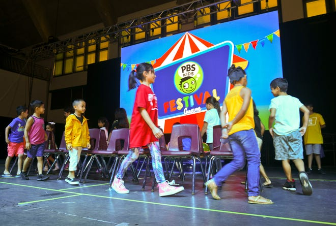 Children participate in a game of musical chairs during the 2019 PBS Kids Festival at the University of Guam's Calvo Field House in Mangilao on Saturday, June 22, 2019, before social distancing requirements. This year, PBS is sponsoring a virtual fitness challenge for people who want to run, walk or wheel their way to fitness in November.