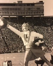 E. Jean Carroll cheerleading at Indiana University in 1965.