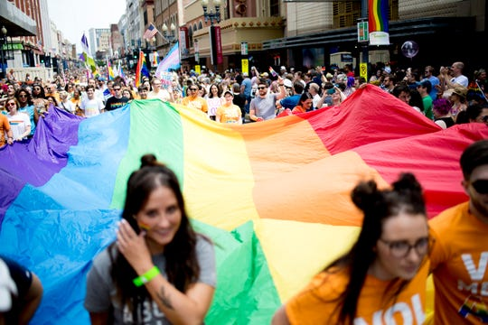 Parade members from UT carry a large Pride flag at the annual Knox Pridefest Parade in downtown Knoxville, Tennessee on Saturday, June 22, 2019.