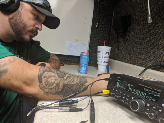 Chris Ancelet, president of the Acadiana Amateur Radio Association, talks to different stations around the world during Ham Radio Field Day Saturday, June 22, 2019, in Church Point.