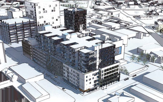 A model of a proposed mixed-used construction incorporating the now-closed Buchanan Street parking garaged proposed by Acadia Design + Development.