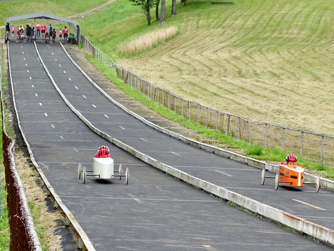 Racers go down the track during Saturday's 64th annual Lancaster Soap Box Derby at Derby Downs.