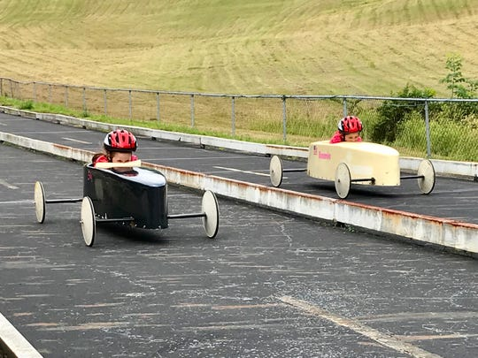 A pair of racers are headed to the finish line during Saturday's Lancaster Soap Box Derby.