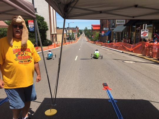 Race organizers work to keep the North Central Ohio Soap Box Derby racers on schedule Saturday downtown Mansfield.