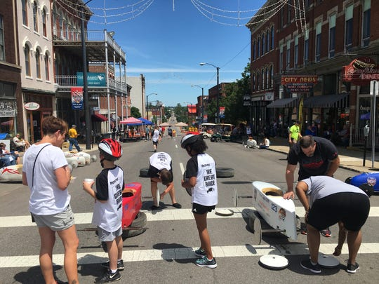 Racers at the North Central Ohio Soap Box Derby Saturday prepare their cars before the race down North Main Street hill.