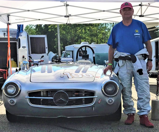 Doug Radix of Oconomowoc, Wisconsin poses with his 1955 Mercedes-Benz as he prepped for a race during the Vintage Grand Prix of Mid-Ohio over the weekend.