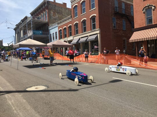 Two racers Saturday headed down the North Main Street hill downtown Mansfield during the annual North Central Ohio Soap Box Derby.