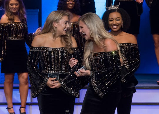 Miss Belle of the D'Arbonne Kaitryana Leinbach (left) won the evening wear competition and Miss Louisiana Watermelon Festival Meagan Crews won the talent competition on Friday night's Miss Louisiana 2019 competition at the W.L. Jack Howard Theatre  in Monroe, La.