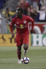 New York Red Bulls midfielder Derrick Etienne Jr. moves the ball up the pitch during the first half of a Major League Soccer match against the Vancouver Whitecaps, Wednesday, May 22, 2019, in Harrison, N.J. The match ended in a 2-2 draw. (AP Photo/Steve Luciano)