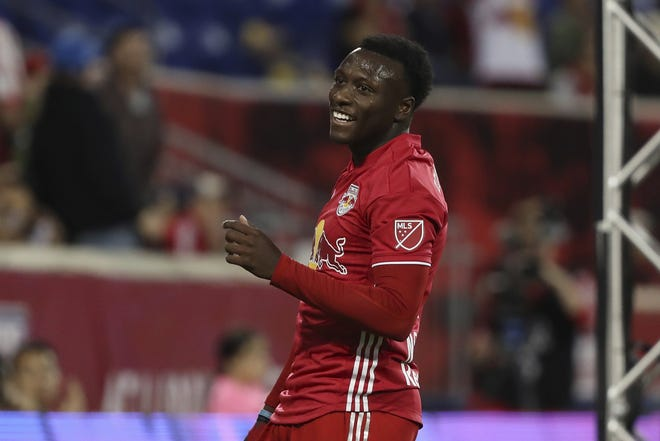 New York Red Bulls midfielder Derrick Etienne Jr. smiles during the first half of a Major League Soccer match against the Vancouver Whitecaps, Wednesday, May 22, 2019, in Harrison, N.J. The match ended in a 2-2 draw. (AP Photo/Steve Luciano)