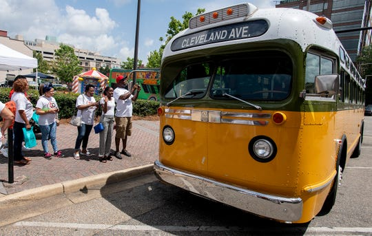 The historic Cleveland Avenue bus is on display as the annual Juneteenth Celebration is held in front of the Rosa Parks Museum in Montgomery, Ala., on Saturday June 22, 2019.
