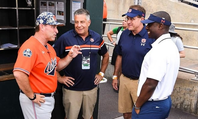 Auburn baseball coach Butch Thompson, men's basketball coach Bruce Pearl, football coach Gus Malzahn and athletics director Allen Greene (from left to right) at the College World Series on June 16, 2019, in Omaha, Nebraska.