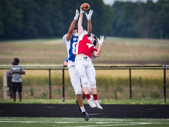East's Tyler Gilland (Delta) blocks a pass during the 19th annual Indiana Hall of Fame All Star Classic game at Delta High School Friday, June 21, 2019.