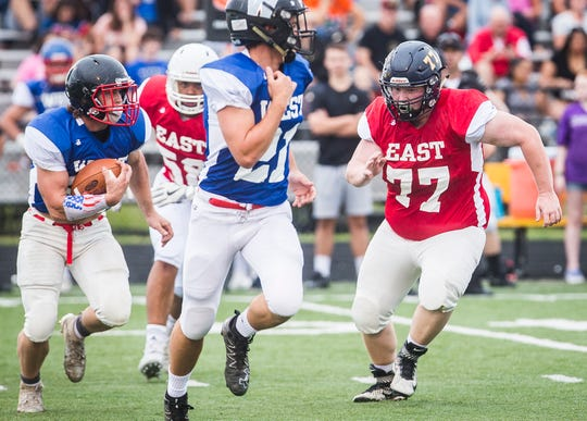 East's Bret Warner (Delta) chases down a West runner during the 19th annual Indiana Hall of Fame All Star Classic game at Delta High School Friday, June 21, 2019.
