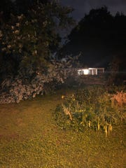 Damage and a downed tree are seen after severe storms Friday night near Glenrose Avenue and Thompson Lane in Nashville.