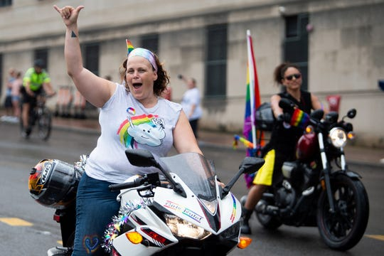 Nicho Bellissima, of Atlanta, Ga., rides down Broadway during the Pride Parade in Nashville, Tenn., Saturday, June 22, 2019.