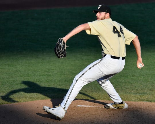 Vanderbilt pitcher Mason Hickman (44) throws against Louisville during the third inning of the 2019 NCAA Men's College World Series game at TD Ameritrade Park  Friday, June 21, 2019, in Omaha, Neb.