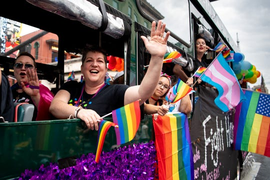Participants wave to the crowd on Broadway during the Pride Parade in Nashville, Tenn., Saturday, June 22, 2019.