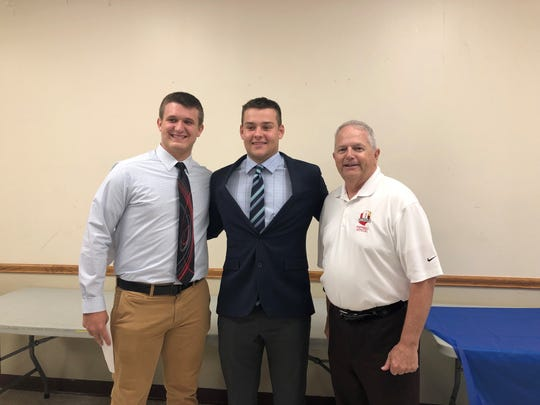 Utica's Mack Marston and Granville's Tommy Wolfe earned scholarships at the Licking-Muskingum banquet on Thursday.