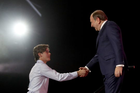 NHL Commissioner Gary Bettman shakes hands with Jack Hughes after being selected first overall by the New Jersey Devils during the first round of the 2019 NHL Draft at Rogers Arena on June 21, 2019 in Vancouver, Canada.