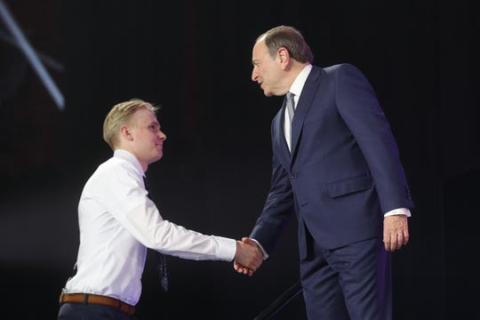 NHL Commissioner Gary Bettman shakes hands with Kaapp Kakko after being selected second overall by the New York Rangers during the first round of the 2019 NHL Draft at Rogers Arena on June 21, 2019 in Vancouver, Canada.