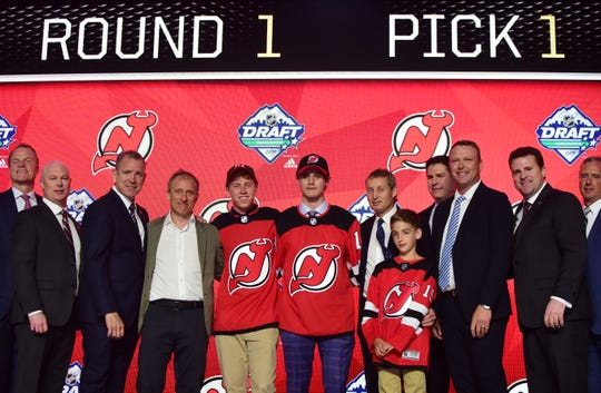 Jun 21, 2019; Vancouver, BC, Canada; Jack Hughes poses for a photo after being selected as the number one overall pick to the New Jersey Devils in the first round of the 2019 NHL Draft at Rogers Arena.